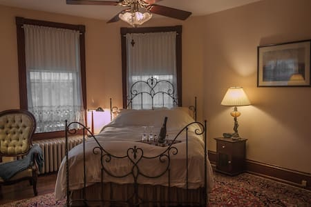 """The most charming B&B in the Washington DC area."" – Travelstar.org. Our comfortable & elegant suite ThePhoenix features generous amenities, warm inviting décor and antique furnishings. Queen size bed, private en-suite bathroom, tub, double shower."