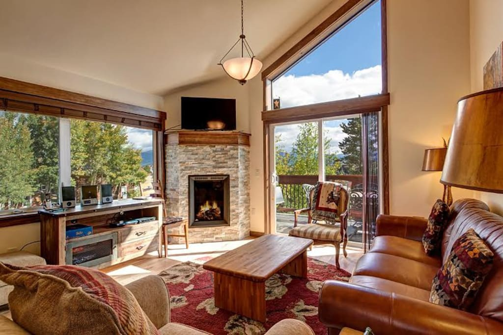 Stone gas fireplace, open layout, console with stereo, and big windows with mountain views!