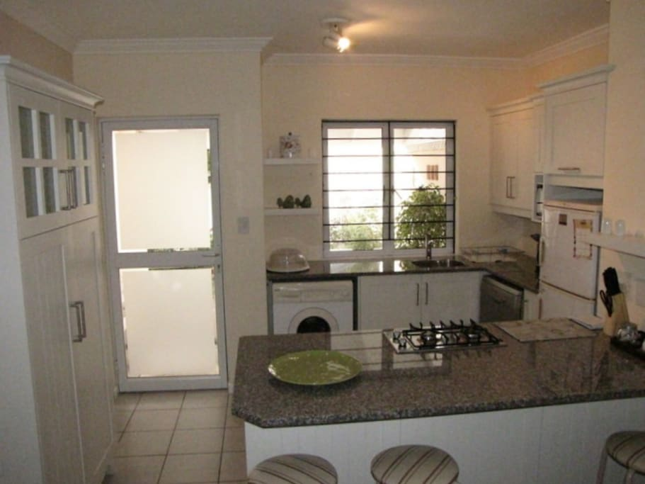 Fully equipped kitchen with washing machine and dishwasher.