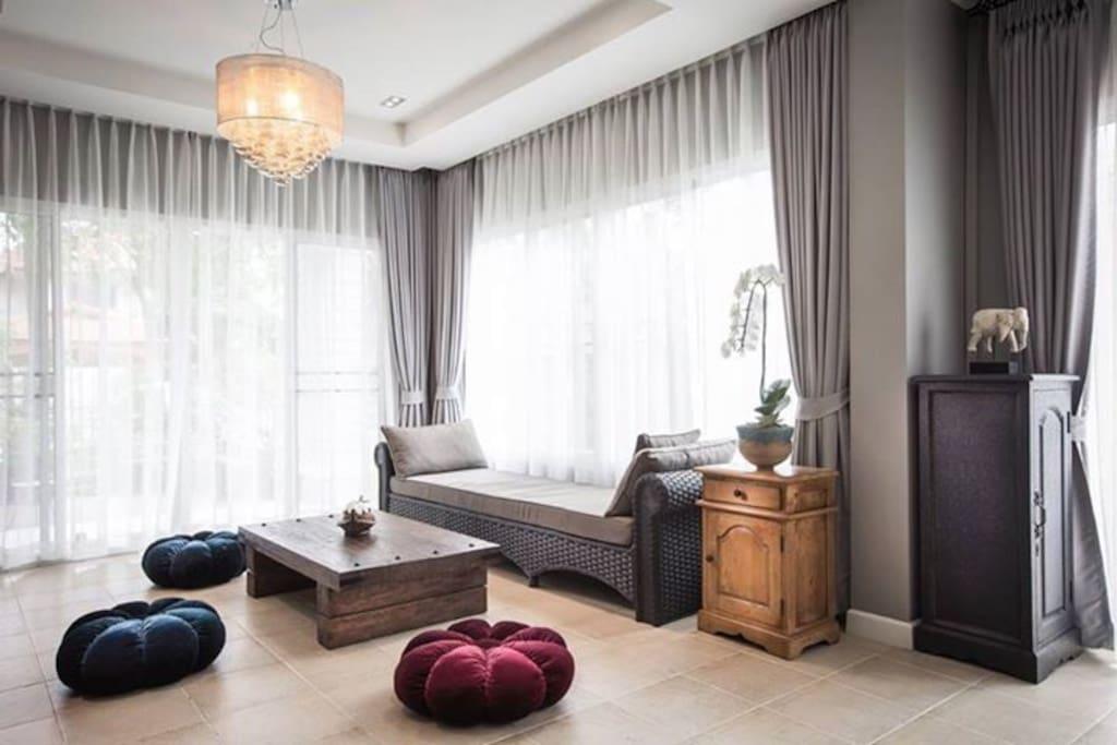 Living room with warm gray , And sofa can sleep comfortably.