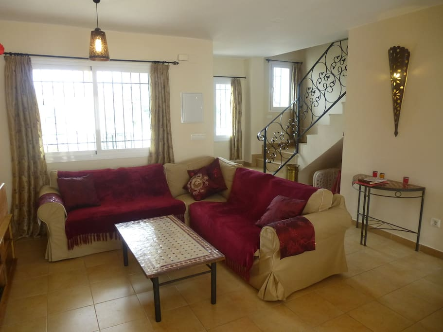 Spacious lounge with comfy sofa, A/C, and flat screen tv