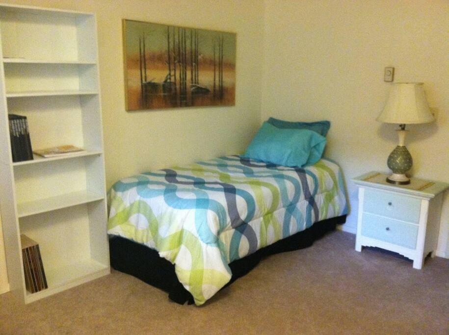 Sealy Bed medium firm Twin. closet, Small dresser, comfy  changing chair and desk.