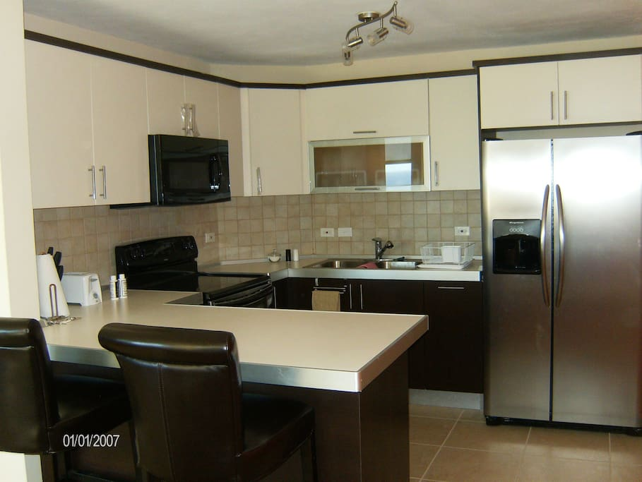 Full equipped kitchen with all utensils you may need.