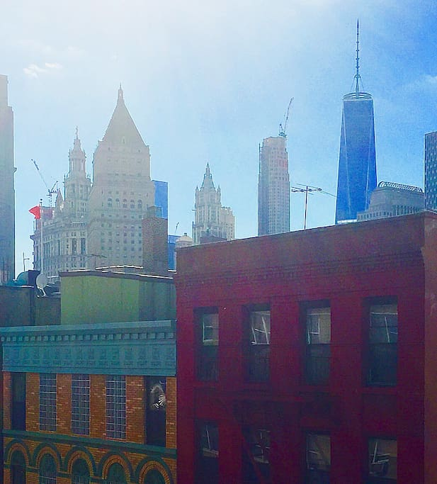 View of Downtown from your window - Freedom Tower, City Hall, Supreme Court & Woolworth Building pictured.