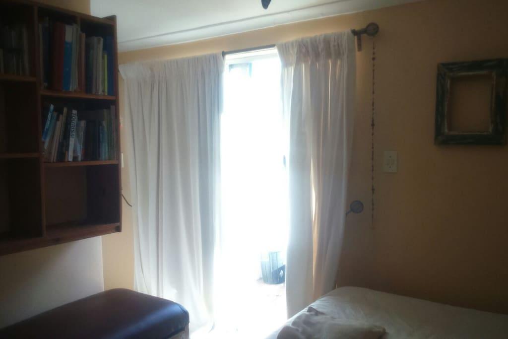 Warm morning light comes through sliding doors