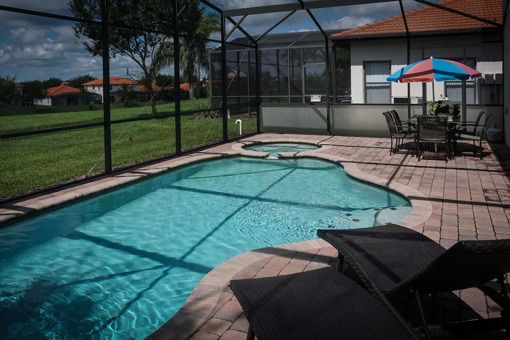 Screened pool and patio with gas grill