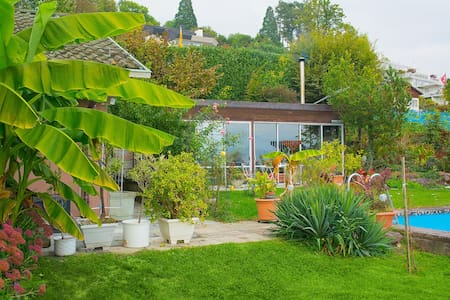 Cozy Bungalow in lush Garden - Meilen