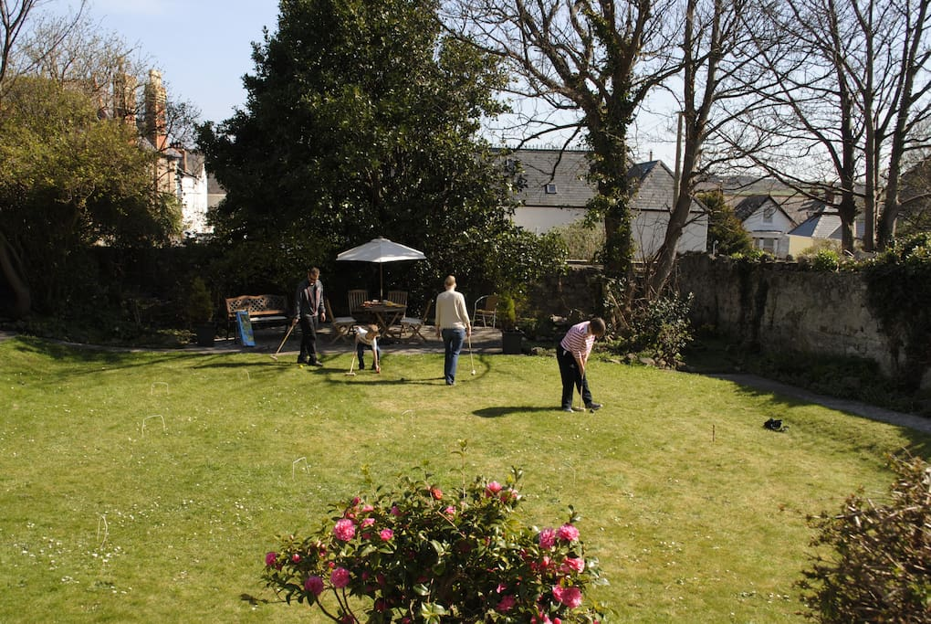 Guests playing croquet in Early Spring in the Garden