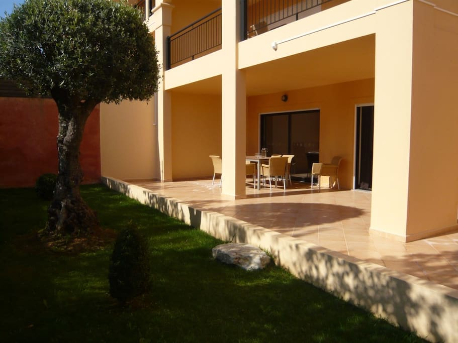 Large private terrace for dining and sunbathing with shady garden