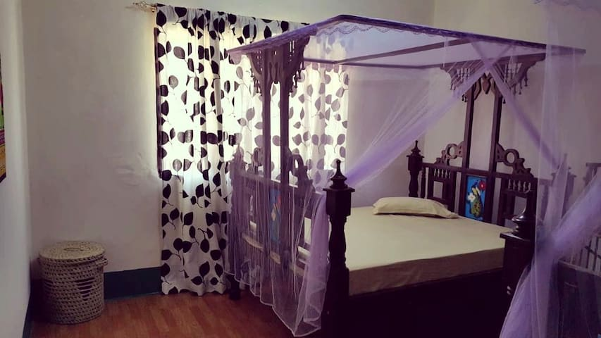 2 Single beds with mosquito nets and fan