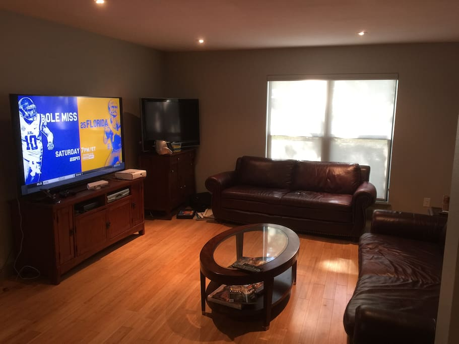 2 Big Screen TVs, Leather couches