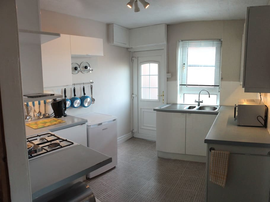 Well equipped kitchen with dishwasher, microwave, fridge and gas cooker.