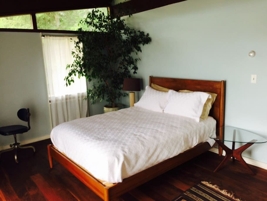 Main bed room with Queen size bed.  Has its own separate access from deck.  Has its own Bathroom and tv room.