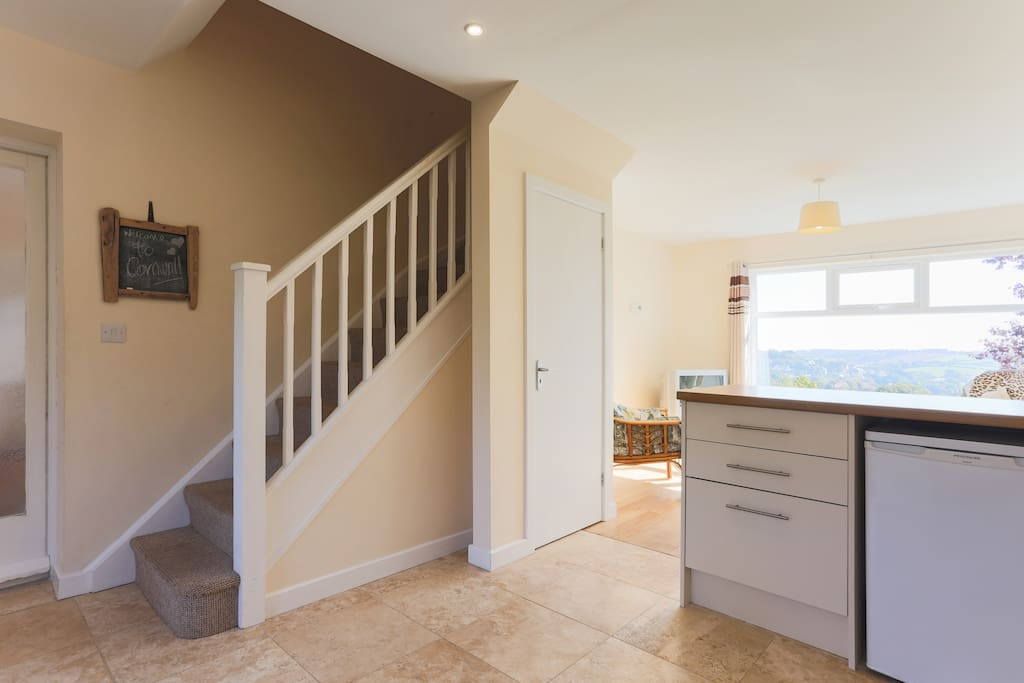 Stairs leading to 2 bedrooms and 2 bathrooms