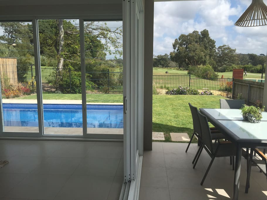 Views from open plan living over pool and golf course