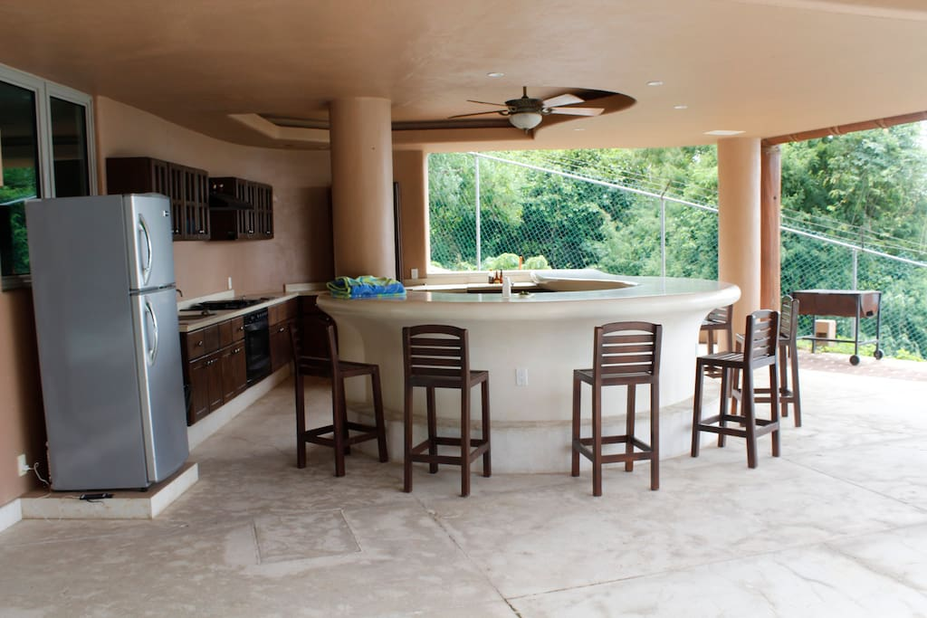 Wet bar with fridge, fan, seats and grill - perfect for friends and family events; you can also play music from your cel phone through wifi surround system