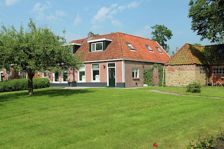 Oldest house of Jelsum in the middle of the Frisian landscape nearby Leeuwarden