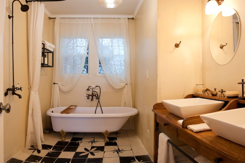 If this is the Bathroom, wait to see the bed! Bath tub and 2 sinks, shower, candles and light