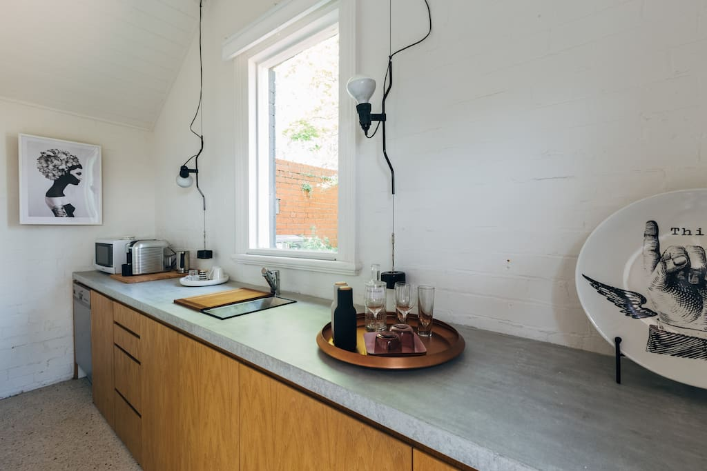 This separate galley kitchen has a dishwasher, coffee machine, fridge, toaster,kettle & hotplate.