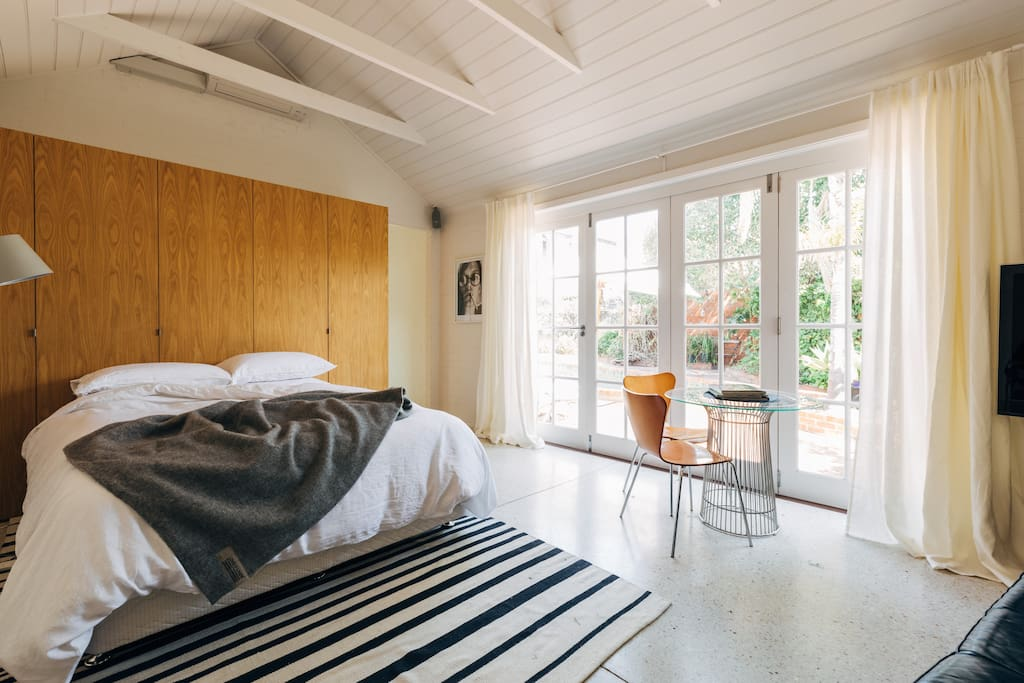 The open loft style bedroom is flooded with natural daylight.