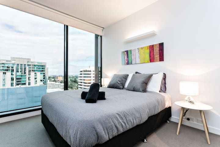 The master bedroom with super comfortable queen bed and amazing view f the bay and Albert Park Lake