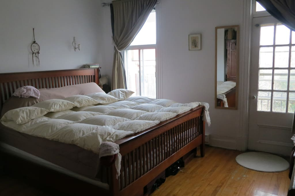 large quiet bedroom with king size bed and balcony