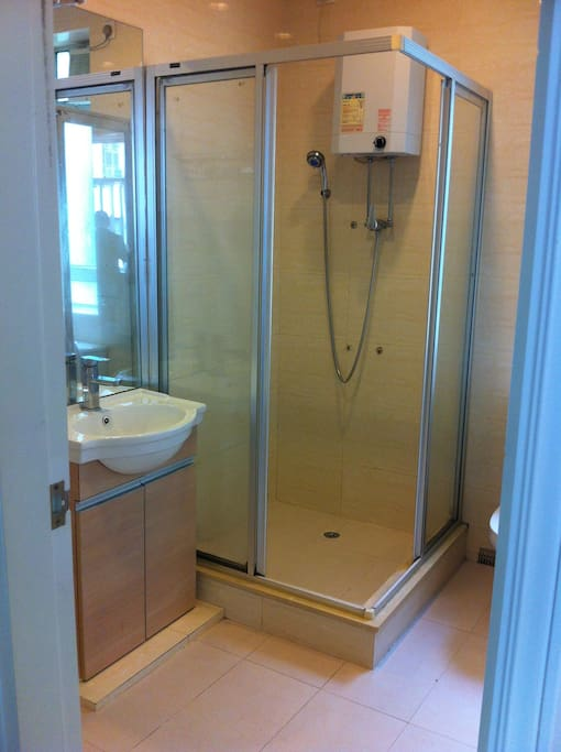 Bathroom with shower stall and washing machine