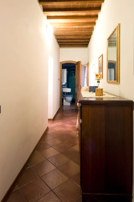 The corridor that leads to the bathroom and the kitchen
