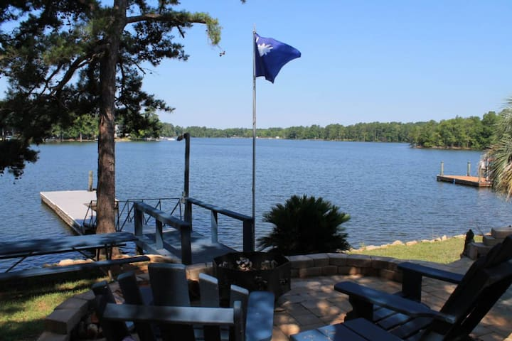 Lakefront, dog-friendly home with a dock and a wrap-around deck!