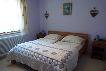 Spacious double room with modern ensuite shower and WC.