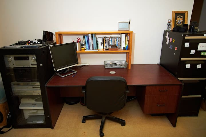 Workspace with a monitor, printer, and peripherals