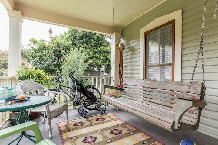 Covered porch with swing and space for bikes