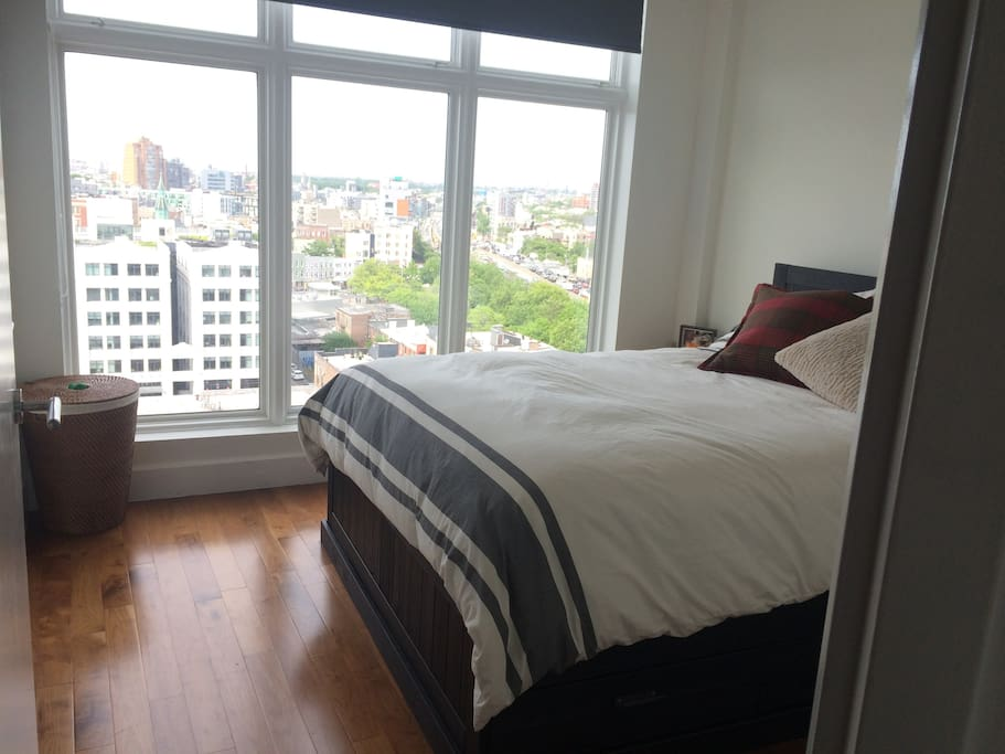 Queen size bed with storage below and large closet (not shown) And black out curtain