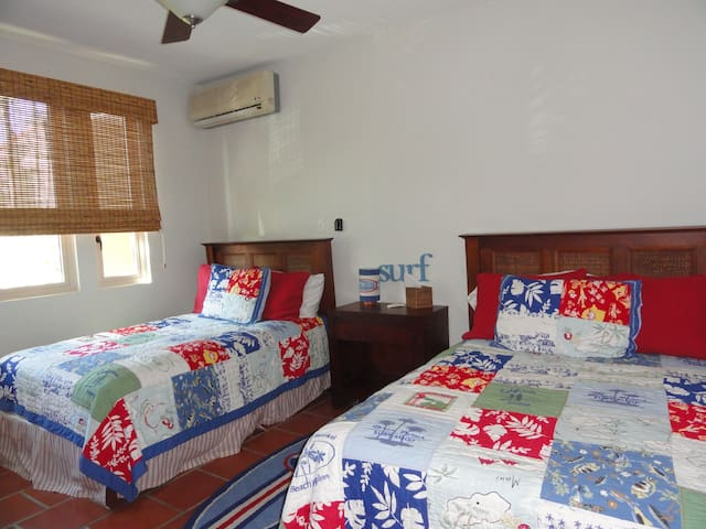 Third Bedroom: Two full beds; Ceiling Fan; Split Unit A-C; Country styling.