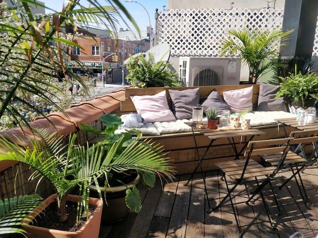 Chambre dans petite maison avec rooftop privé