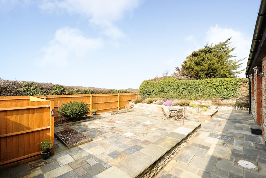 Large secluded suntrap patio.
