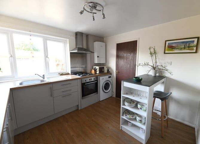 Shared kitchen, with breakfast bar, gas hob, oven, microwave, washing machine (available for use for a small fee).