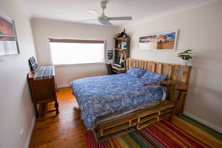 Main bedroom - Queen Bed, comes with built in wardrobe, ceiling and and study desk.