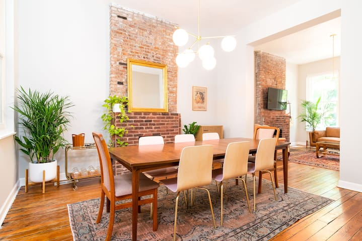 The dining room comfortably sits eight, perfect for dinner or a game night.