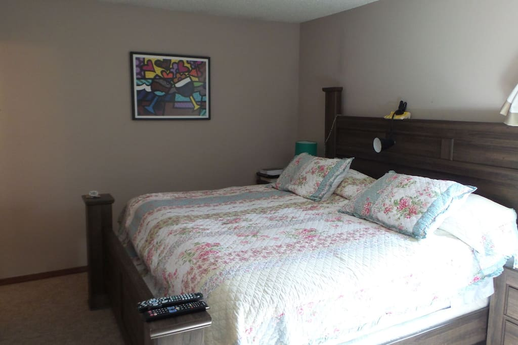 king size bedroom with private 1/2 bathroom