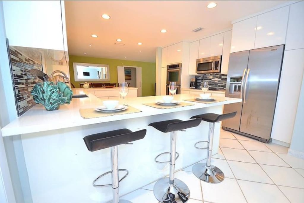 Spacious Open Kitchen (Fully Equipped) Features Quartz Counters (Barstool Dining) + Pool Lounge Views + Access...