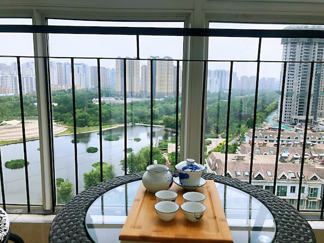 风景水岸 | 落地阳台茶阁 | 大床电视 | 可做饭 | 有冰箱 |