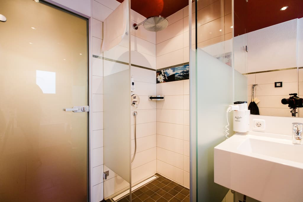 Bahroom with rain shower and separate toilet
