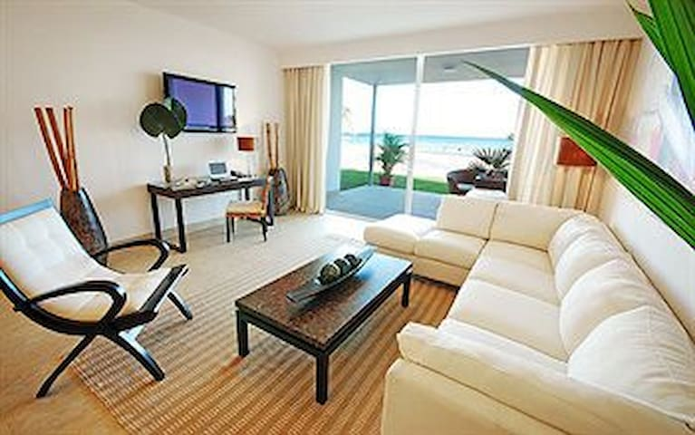 ground level apartment with direct exit to beach!