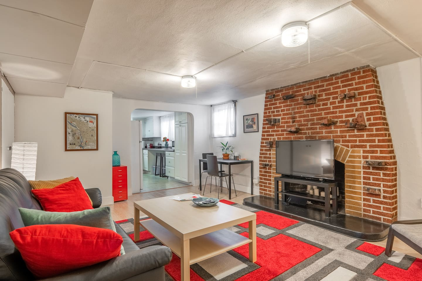 The apartment is in the lower level of a 100 year old craftsman bungalow and has some classic features, but is furnished with crisp, colorful, urban style.