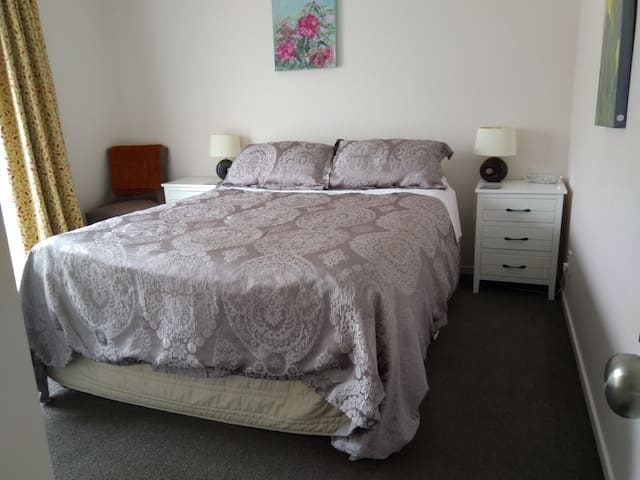 Main bedroom with Queen bed and door out to the garden