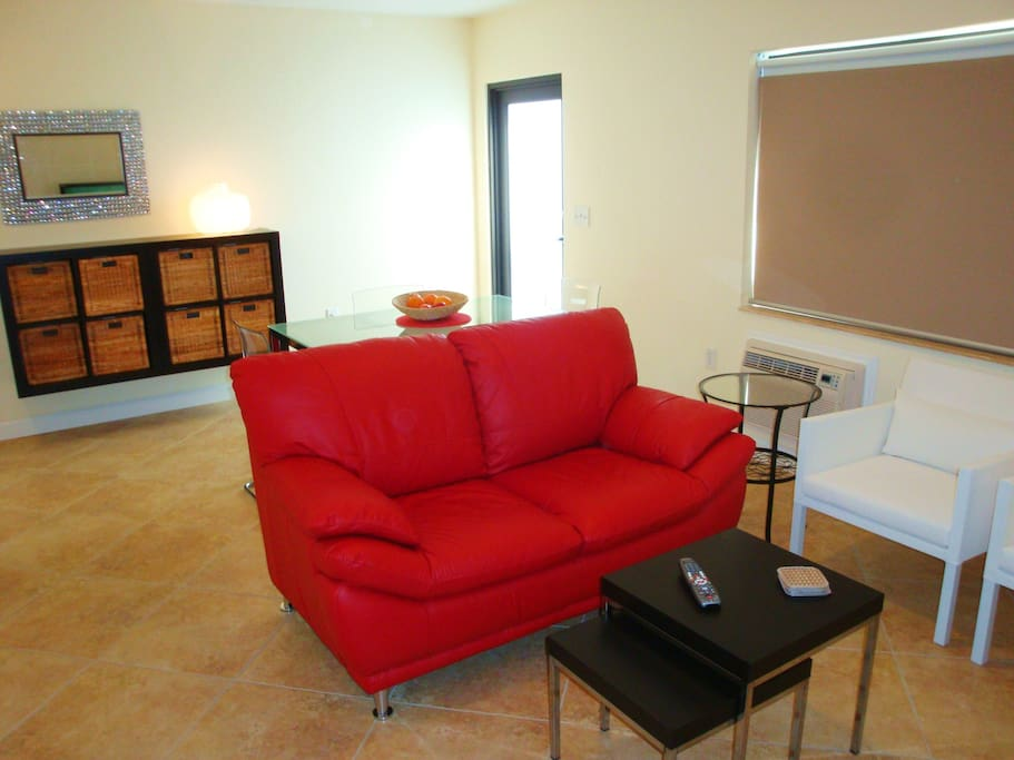 Enjoy HDTV in the living area on the new leather couch and chairs.