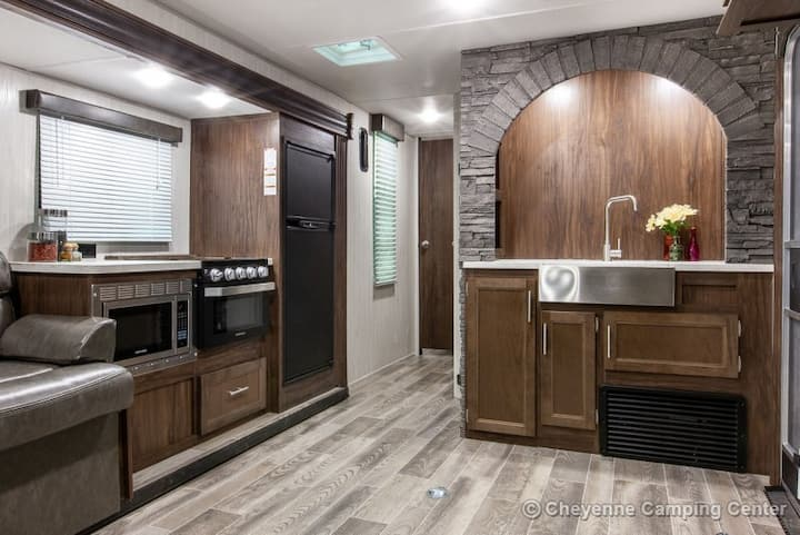 RV with access to pool with waterfall and tiki hut