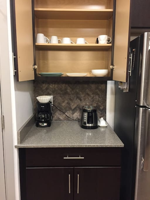 Dishes, coffee maker and toaster
