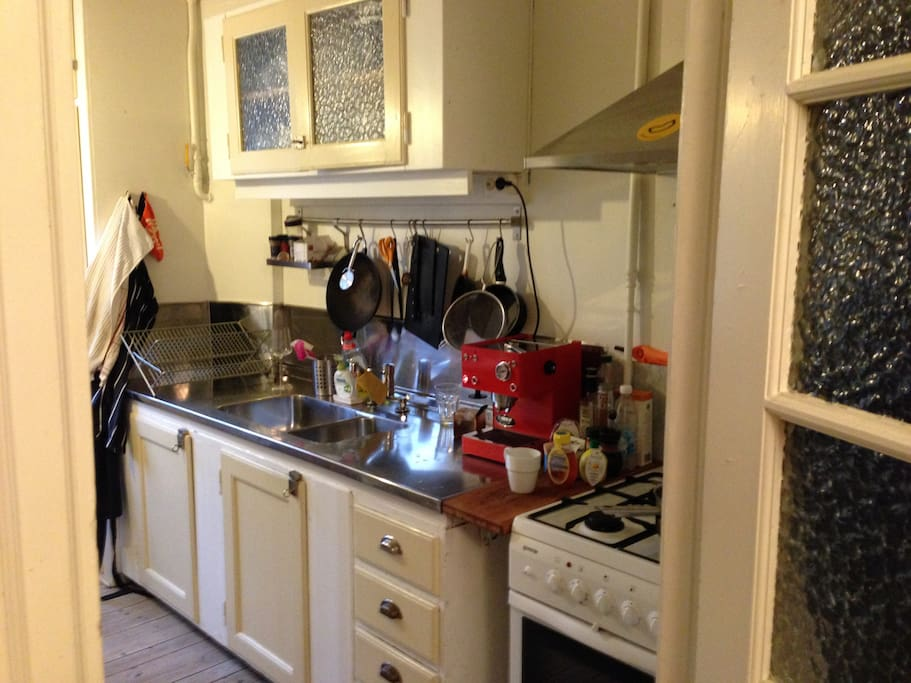 Fully equipped kitchen with stove , oven, fridge, freezer, espresso machine.